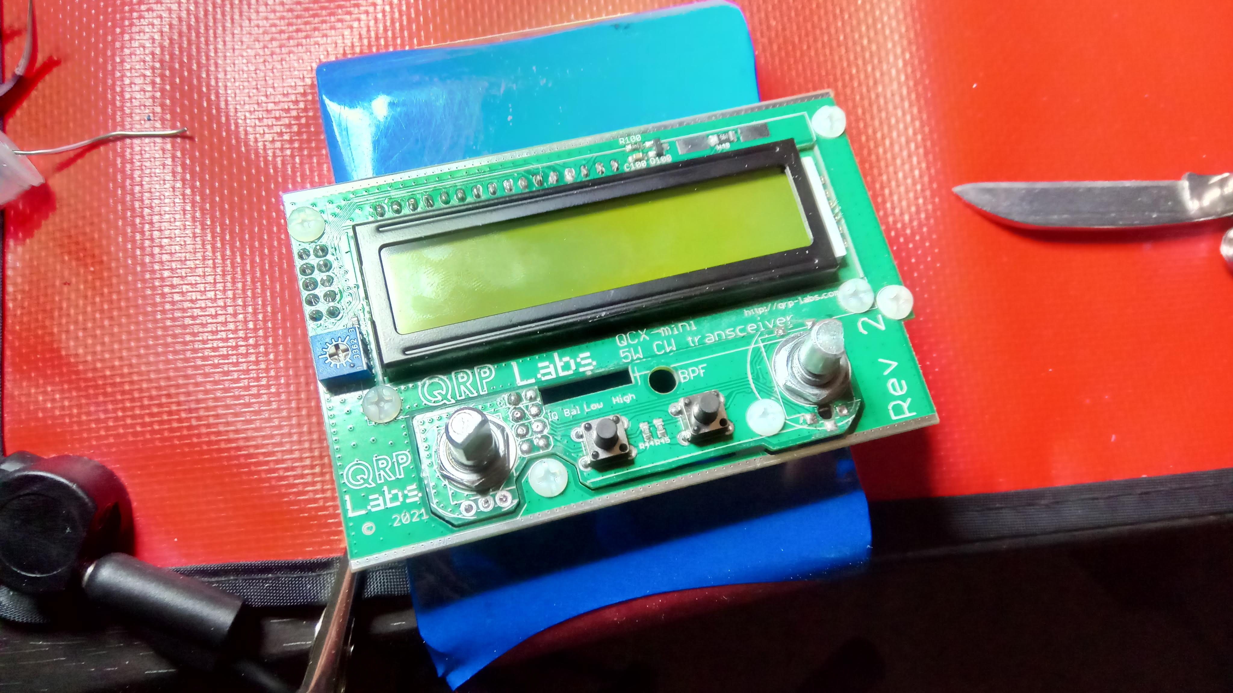 Make sure control board squeezes through the hole in the display board